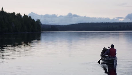 Man canoeing on a lake